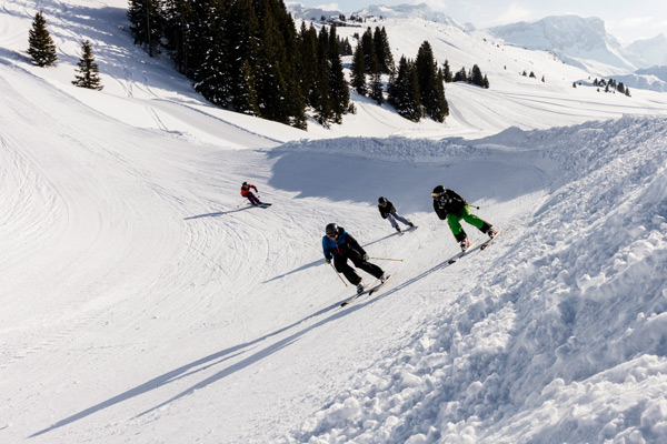 Steep wall surfing and winning the race among friends. This is the skicross at the Betelberg